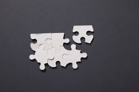 One puzzle piece apart from the rest waiting to be connected to the team Фото со стока