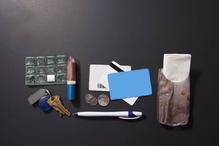 Contents of what might be in a person's purse or bag