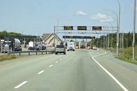 Cobequid Pass, Nova Scotia - July 26, 2019: Approaching the pay tolls at the Cobequid Pass section of highway 104 in Nova Scotia