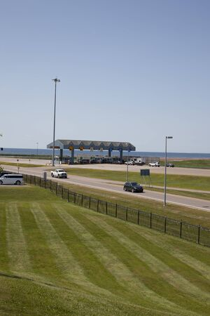 July 26, 2019- Borden Carleton, PEI: Vertical shot of the pay tolls to leave Prince Edward Island onto the Confederation Bridge