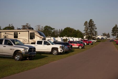 Cavendish, PEI- July 27, 2019: A line of trucks with RVs or winnebagos on a camp ground