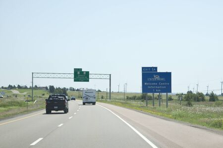 Amherst, Nova Scotia - July 28, 2019: A blue sign marks the entrance to the Province of Nova Scotia along the Tantramar Marsh