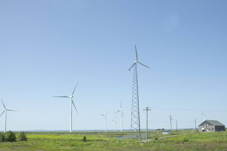 Amherst, Nova Scotia- July 28, 2019: View of turbines on Tantramar Marsh with windmills passing from the highway