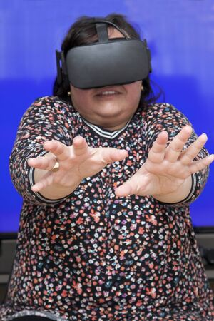 Person experiencing a virtual reality headset is very scared of what they see Фото со стока