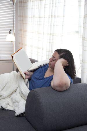comfortable reading at home Banco de Imagens