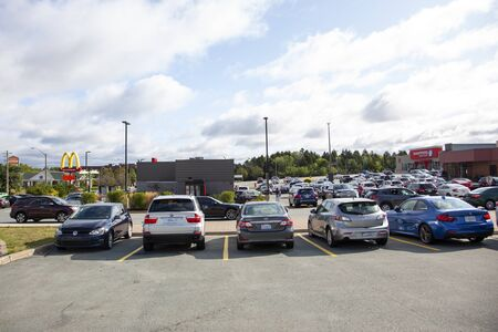 September 8, 2019 - Clayton Park, Halifax, Nova Scotia - piles of cars and people trying to get to MacDonalds and Tim Hortons the morning after Hurricane Dorian