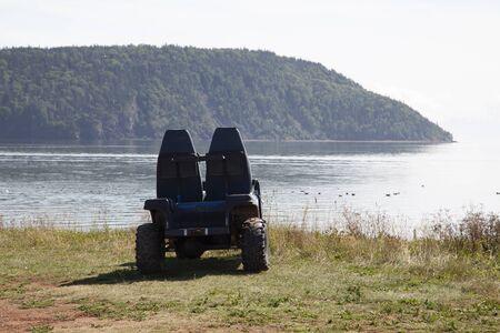 an empty ATV ready for adventure on a sandy canadian beach