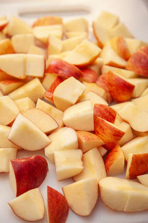 red and yellow sliced apples ready for baking