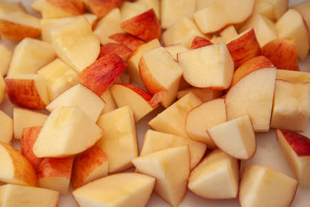 juicy fresh local apples on a cutting board have been cut and sliced up