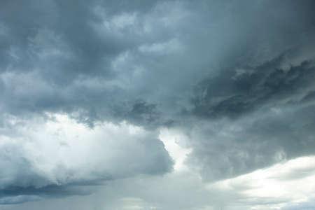 Looking up at the dark stormy clouds in the heavenward sky Stock fotó