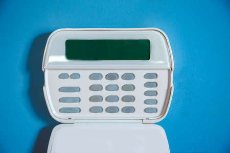a key pad with blank buttons part of a digital security system on the wall in a house or office