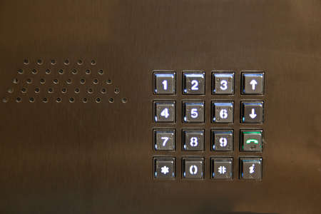 key pad for entering numbers or calling up to a unit or entering password with an audio speaker