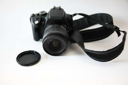 Mid 2000s model digital camera with neck strap and lens cap Zdjęcie Seryjne
