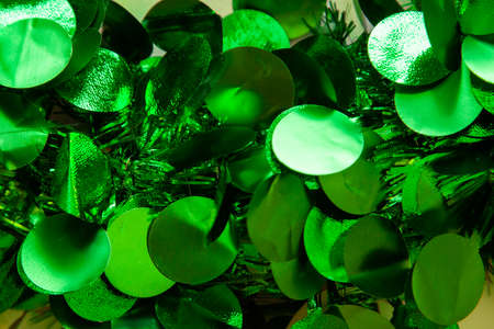 Tiny shining green flakes on a green christmas wreath make an abstract background