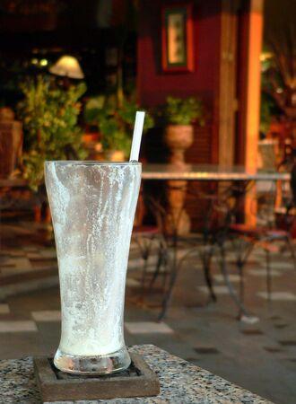 drank: Empty Milkshake Glass & Straw Stock Photo
