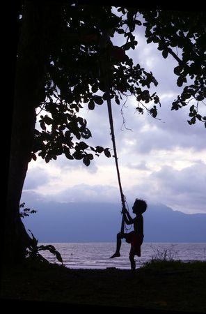 Kid on Swing Borneo Coast photo