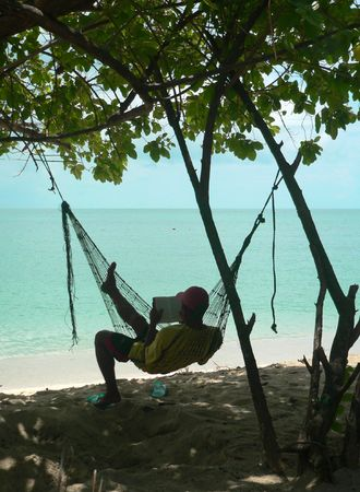 Hammock Reader Coral Beach Sulu Sea SE Asia photo