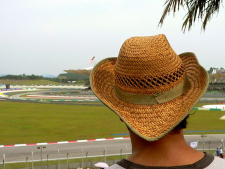 rainwear: Hat on Spectator. Motor Sport, Malaysia