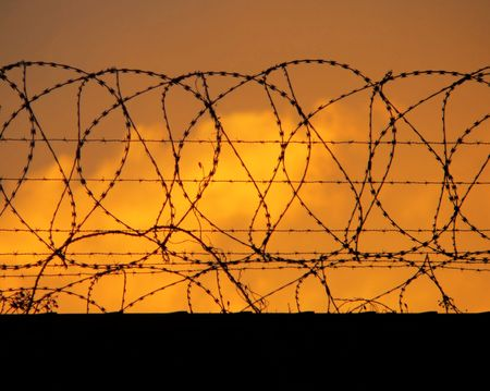 fencing wire: Barbed Perimeter Fence 1of2 Stock Photo
