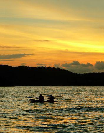 Langkawi Beach. Kayak  Canoe at Sunset photo