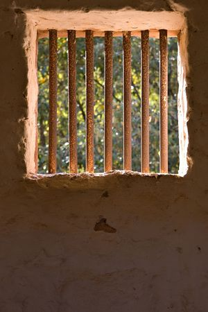 prison bars with trees and light outside Stock Photo - 791911