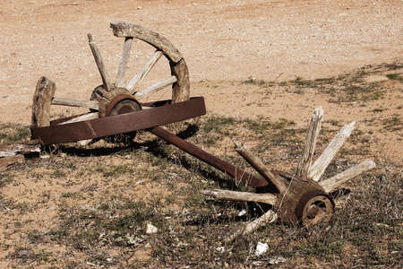 axle: old broken cart wheels and axle Stock Photo