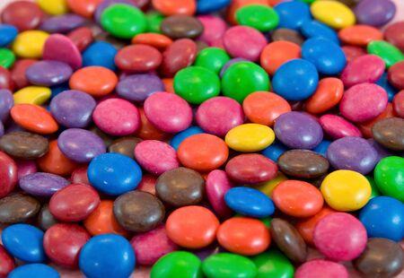background pile of smarties chocolates photo