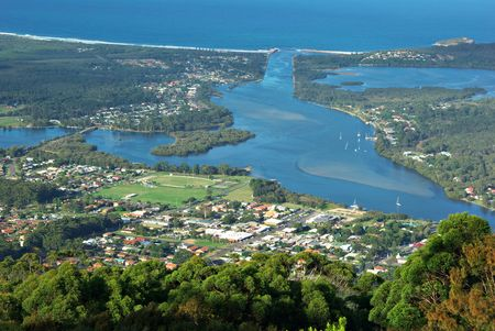 inlet bay: looking down from high up at the houses and the town of laurieton on the north coast of new south wales (nsw) Stock Photo