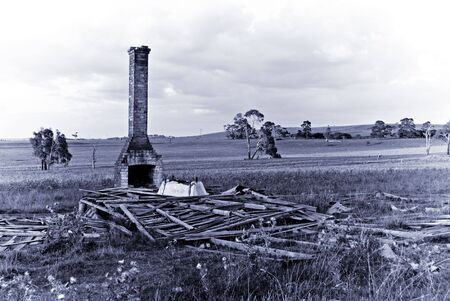 days gone by: a purple tone image of old ruins of a farmhouse symbolising the past and days gone by