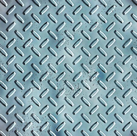 treadplate: a large sheet of rough and pitted blue steel diamond or tread plate Stock Photo