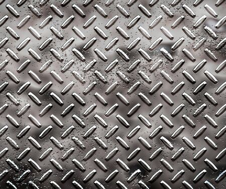 treadplate: a very large sheet of rough black diamond plate with pits and marks