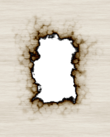 burnt out: old paper or parchment with hole burnt out of middle as a frame Stock Photo