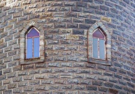 two old windows in the castles tower wall photo