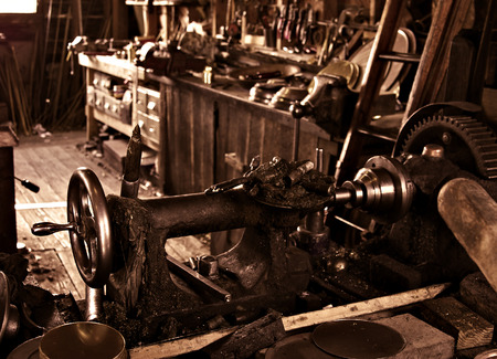 craftman: an old busy and cluttered workshop in russet