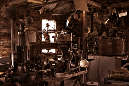 russet: an old busy and cluttered workshop in russet
