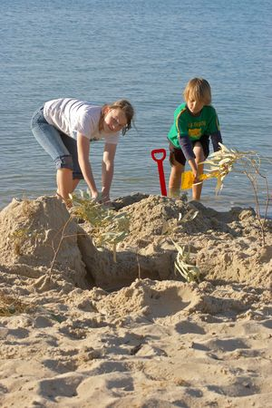 sandcastles: children playing and building sancastles on the beach Stock Photo