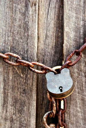 old lock and chain around wooden fence Stock Photo - 2103305