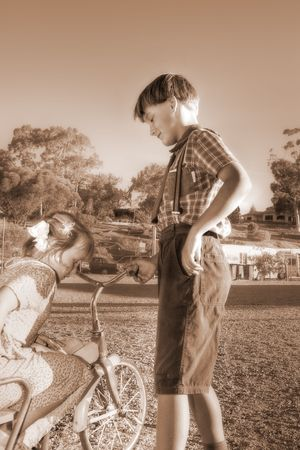 diffused image of a young gentleman helping a little girl of the old tricycle  Stock Photo - 2258080