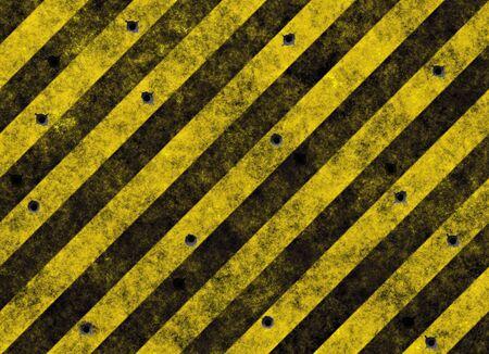 hazard stripes: old grungy yellow hazard stripes on black road full of bulletholes
