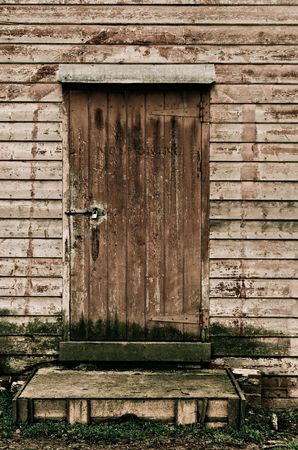 Stock Photo   The Old Wooden Shed Door Stays Locked