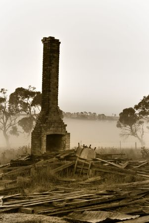 resolute: the chimney stands resolute amongst the rubble in bleak times