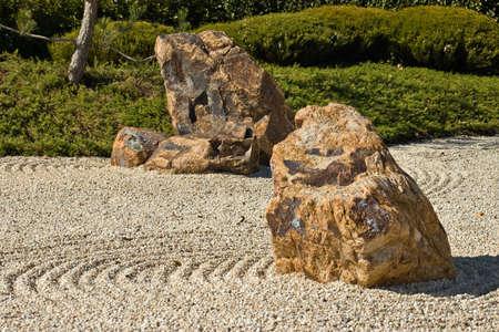 raked: japanese rock garden showing raked gravel stones