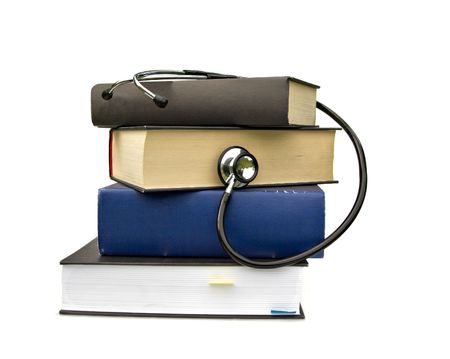 studying medicine or research book with stethoscope on white photo