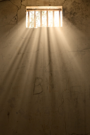 sunlight pours in through the prison window photo