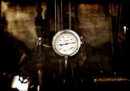gritty and grungy image of machinery under pressure gauge lets out steam Stock Photo