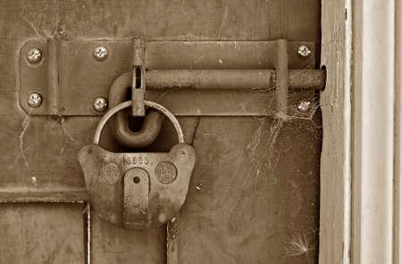 big old lock keeps this door shut Stock Photo - 2801492