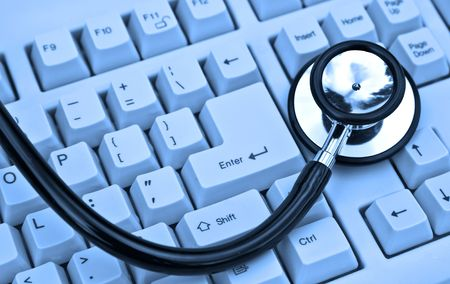 stethoscope on a keyboard in cool blue Stock Photo