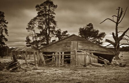 sepia image of an old derelict farm building photo