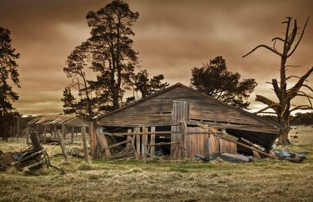 derelict: old farm building all forgotten and falling down Stock Photo