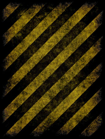 restricted: old grungy yellow hazard stripes on black road